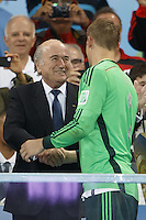 FIFA President Sepp Blatter and Goalkeeper Manuel Neuer of Germany shake hands near the World Cup trophy