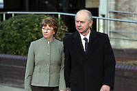 Pictured: Malcolm Fyfield (R) with his wife leaving Swansea Crown Court. Thursday 27 March 2014<br />