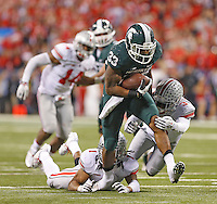 Ohio State Buckeyes cornerback Bradley Roby (1) nor Ohio State Buckeyes defensive back Corey Brown (3) can stop Michigan State Spartans running back Jeremy Langford (33) from scoring a Spartans TD with a little more than 2 minutes left at Lucas Oil Stadium in Indianapolis, Ohio on December 7, 2013.  (Chris Russell/Dispatch Photo)