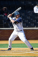 Christian Venditti (8) of the Georgetown Hoyas at bat against the Marshall Thundering Herd at Wake Forest Baseball Park on February 15, 2014 in Winston-Salem, North Carolina.  The Thundering Herd defeated the Hoyas 5-1.  (Brian Westerholt/Four Seam Images)
