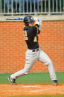 Rob Malan (12) of the Virginia Commonwealth Rams follows through on his swing against the Charlotte 49ers at Robert and Mariam Hayes Stadium on March 30, 2013 in Charlotte, North Carolina.  The 49ers defeated the Rams 9-8 in game one of a double-header.  (Brian Westerholt/Four Seam Images)