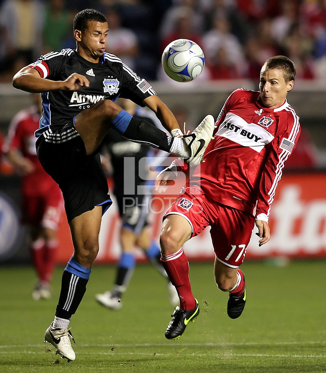 San Jose defender Jason Hernandez (21) clears the ball in front of Chicago forward Chris Rolfe (17).  The Chicago Fire defeated the San Jose Earthquakes 2-0 at Toyota Park in Bridgeview, IL on July 18, 2009.