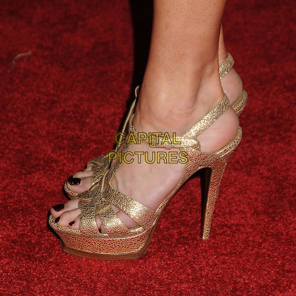 "TAYLOR ARMSTRONG's shoes .Oxfam America and Esquire House LA Host ""The Oxfam Party"" held at Esquire House LA, Los Angeles, California, USA, .18th November 2010..detail feet sandals YSL tribute shoes platform high heels .CAP/ADM/BP.©Byron Purvis/AdMedia/Capital Pictures."
