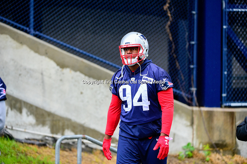 June 6, 2017: New England Patriots defensive end Kony Ealy (94) walks to practice in the rain at the New England Patriots mini camp held on the practice field at Gillette Stadium, in Foxborough, Massachusetts. Eric Canha/CSM