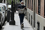 A man reads the newspaper while walking his dog along a street in the center of Madrid during the health crisis due to the Covid-19 virus pandemic - Coronaviruss. April 28,2020. (ALTERPHOTOS/Alejandro de Dios)