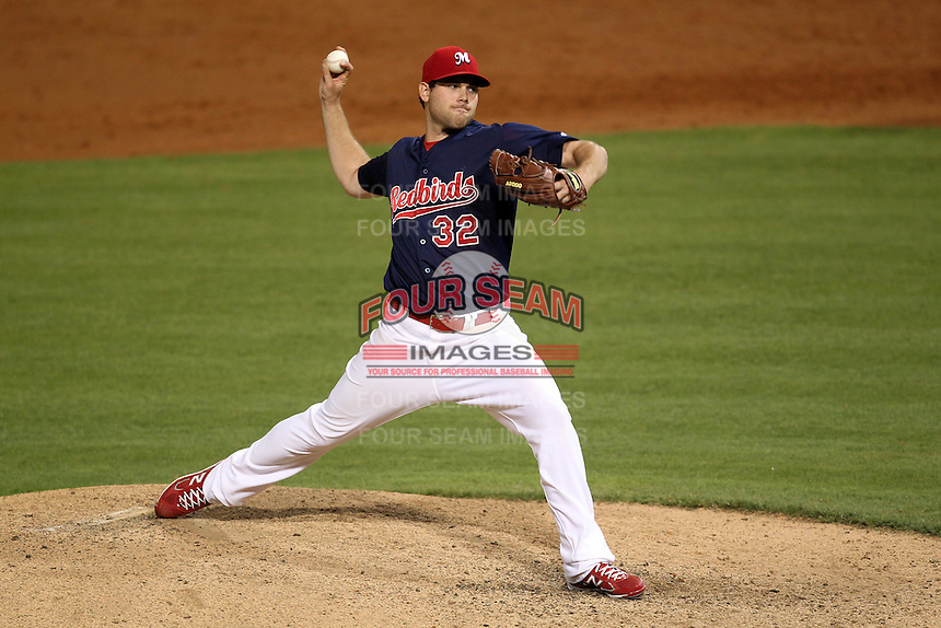 Memphis Redbirds pitcher Adam Ottavino #32 delivers a pitch during a game versus the Round Rock Express at Autozone Park on April 28, 2011 in Memphis, Tennessee.  Memphis defeated Round Rock by the score of 6-5 in ten innings.  Photo By Mike Janes/Four Seam Images