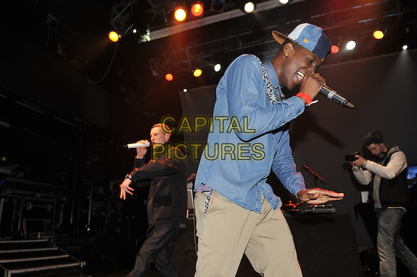 James Devlin & Labrinth (Timothy McKenzie).performing at the SBTV Christmas Party, Koko, Camden, London, England..21st December 2011.on stage in concert live gig performance half length jeans denim black shirt singing blue side.CAP/MAR.© Martin Harris/Capital Pictures.