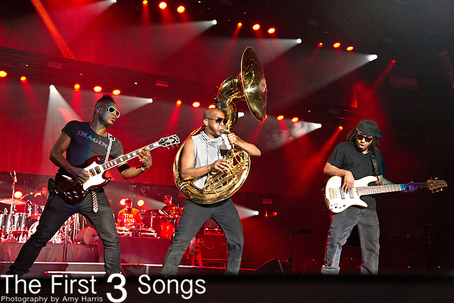 Captain Kirk Douglas, Tuba Gooding Jr., and Mark Kelley of The Roots perform during the 2014 Essence Festival at the Mercedes-Benz Superdome in New Orleans, Louisiana.