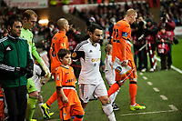 Thursday 28 November  2013  Pictured: Leon Britton leads the team on to the pitch <br /> Re:UEFA Europa League, Swansea City FC vs Valencia CF  at the Liberty Staduim Swansea