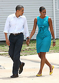 United States President Barack Obama and Lady Michelle walk out to speak at a Coast Guard base in Panama City, Florida USA on Saturday, 14 August  2010. The First Family is visiting the area to help promote tourism and check up on clean up efforts from the aftermath of the Deepwater Horizon Oil spill. .Credit: Dan Anderson / Pool via CNP