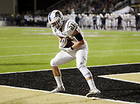 NWA Democrat-Gazette/CHARLIE KAIJO Bentonville West High School Jonas Higson (21) scores during a football game, Friday, November 2, 2018 at Bentonville High School in Bentonville.