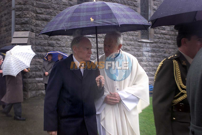 Former Taoiseach Liam Cosgrove (Left) being escorted out of the church behind the cofin of Paddy Donegan.Pic Fran Caffrey Newsfile