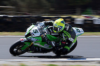 Alexander Lundh (SWE) riding the Kawasaki ZX-10R (5) of the Pedercini Team rounds turn 11 during a practise session on day two of round one of the 2013 FIM World Superbike Championship at Phillip Island, Australia.