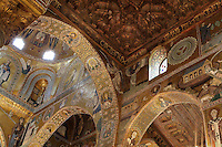 Saracen arches and Byzantine mosaics in the choir of the Cappella Palatina (Palatine Chapel), 1130 - 1140, by Roger II, within the Palazzo dei Normanni (Palace of the Normans), Palermo, Sicily, Italy. Picture by Manuel Cohen