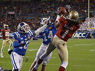 December 7, 2013  (Charlotte, North Carolina)  Florida State Seminoles wide receiver Kelvin Benjamin #1 catches a pass for a touchdown in the 2013 ACC Championship game as Duke Blue Devils safety Jeremy Cash #16 and cornerback Bryon Fields #14 defend. (Photo by Don Baxter/Media Images International)