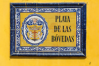 Cartagena, Colombia.  Tiled Plaza Sign, Las Bovedas (The Dungeons), Shops Selling Handicrafts, Fabrics, and other Souvenirs for the Tourist Trade.
