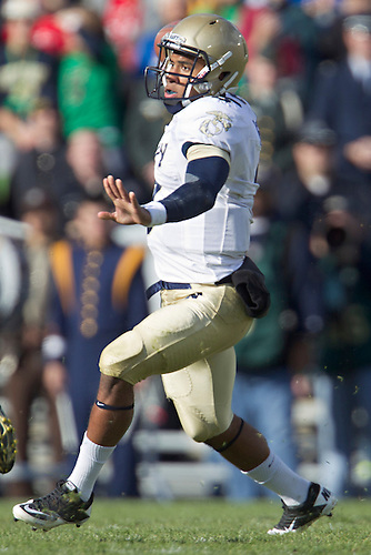 Navy quarterback Trey Miller (#3) passes the ball during first quarter of NCAA football game between Notre Dame and Navy.  The Notre Dame Fighting Irish defeated the Navy Midshipmen 56-14 in game at Notre Dame Stadium in South Bend, Indiana.