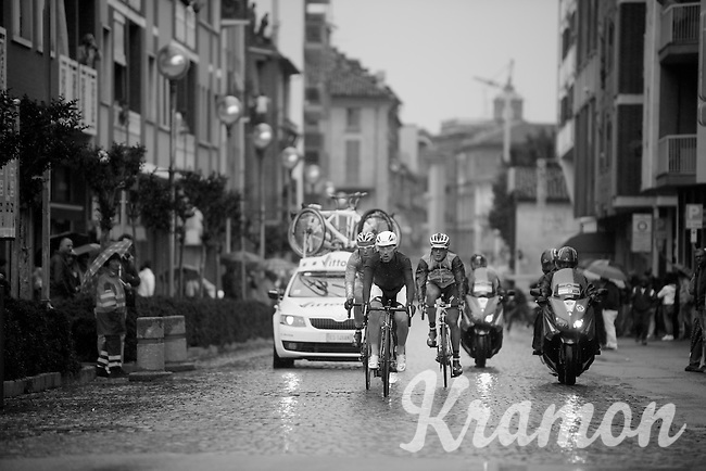 2013 Giro d'Italia.stage 14: Cervere - Bardonecchia.168km..Luca Paolini (ITA) leading an early breakaway in the wet cobbled main street of Savigliano