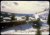 Train of box cars &amp; gondolas possibly west of Antonito.<br /> DRGW  w. of Antonito ?, CO