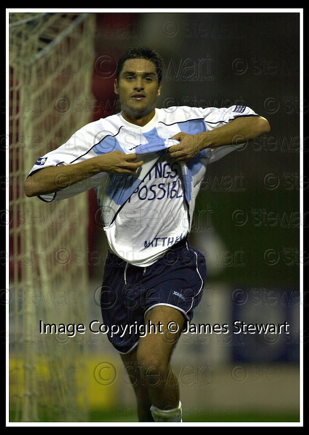 08/12/2001                 Copyright Pic : James Stewart .Ref : DSC_8152                          .File Name : stewart03-st johnstone v dundee.JUAN SARA CELEBRATES AFTER HE SCORES DUNDEE'S FIRST GOAL......James Stewart Photo Agency, Stewart House, Stewart Road, Falkirk. FK2 7AS      Vat Reg No. 607 6932 25.Office     : +44 (0)1324 630007     .Mobile  : + 44 (0)7721 416997.Fax         :  +44 (0)1324 630007.E-mail  :  jim@jspa.co.uk.If you require further information then contact Jim Stewart on any of the numbers above.........