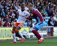 Blackpool's Armand Gnanduillet takes on Scunthorpe United's Byron Webster<br /> <br /> Photographer David Shipman/CameraSport<br /> <br /> The EFL Sky Bet League One - Scunthorpe United v Blackpool - Friday 19th April 2019 - Glanford Park - Scunthorpe<br /> <br /> World Copyright © 2019 CameraSport. All rights reserved. 43 Linden Ave. Countesthorpe. Leicester. England. LE8 5PG - Tel: +44 (0) 116 277 4147 - admin@camerasport.com - www.camerasport.com