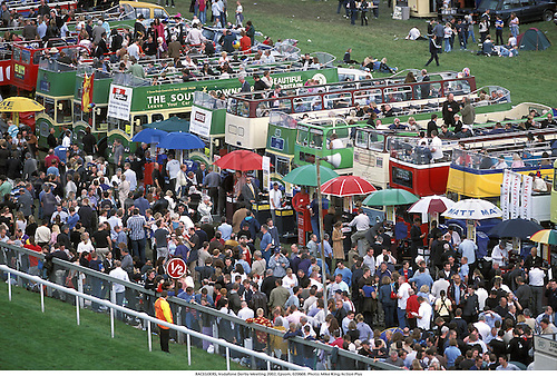 RACEGOERS, Vodafone Derby Meeting 2002, Epsom, 020608. Photo: Mike King/Action Plus...horse racing.crowds crowd punter punters racegoer racegoers.bus buses.220