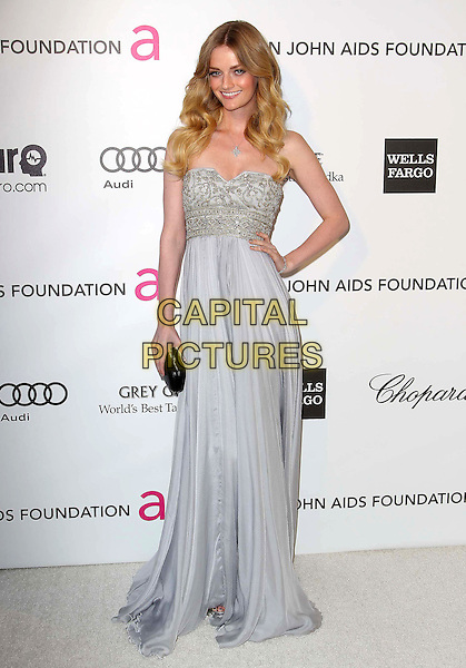 Lydia Hearst.21st Annual Elton John Academy Awards Viewing Party held at West Hollywood Park, West Hollywood, California, USA..February 24th, 2013.oscars full length dress hand on hip blue gold strapless beads beaded  black clutch bag.CAP/ADM/KB.©Kevan Brooks/AdMedia/Capital Pictures.