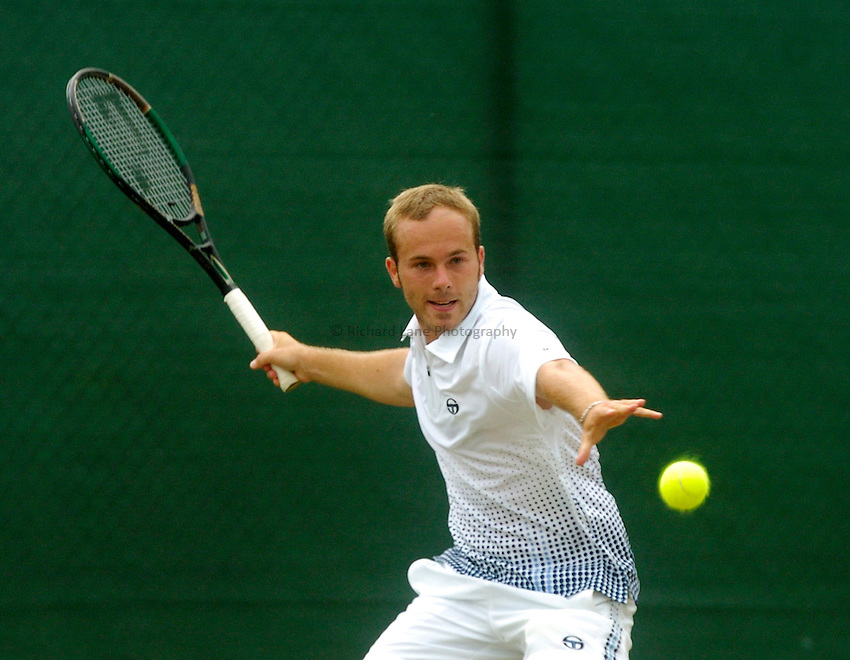 Photo. Glyn Thomas. .Nottingham Open Tennis, day 2..15/06/2004..Olivier Rochus plays a forehand shot.