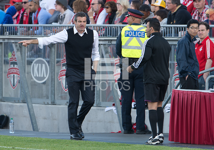 18 May 2013: Toronto FC head coach Ryan Nelsen talks with the second referee on the sidelines during an MLS game between the Columbus Crew and Toronto FC at BMO Field in Toronto, Ontario Canada..The Columbus Crew won 1-0...