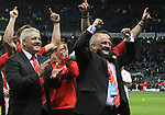 Head coach Warren Gatland and team manager Alan Phillips celebrate as the Triple Crown is presented to Wales..RBS 6 Nations 2012.England v Wales.Twickenham.25.02.12.Credit: STEVE POPE - Sportingwales