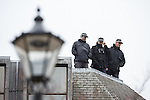 © Joel Goodman - 07973 332324 . 23/10/2015 . Manchester , UK . Armed police on the roof of Heron House opposite Manchester Town Hall waiting during the visit of Chinese president , Xi Jinping , to Manchester as part of his state visit to the United Kingdom . Photo credit : Joel Goodman