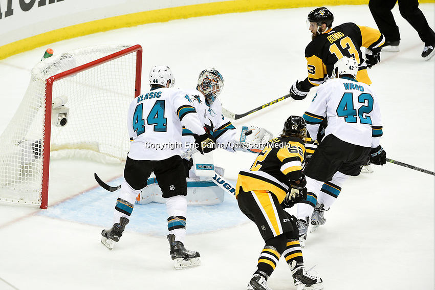 Monday, May 30, 2016: San Jose Sharks goalie Martin Jones (31) gloves the puck during the NHL Stanley Cup Finals between the San Jose Sharks and the Pittsburgh Penguins held at the CONSOL Energy Center in Pittsburg Pennsylvania. The Penguins beat the Sharks 3-2 in regulation time. Eric Canha/CSM