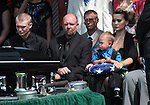 Family members of Colorado shooting victim Jonathan Blunk attended a memorial service in Reno, Nev. on Friday morning, Aug. 3, 2012. From left are, Blunk's brother Dillon Blunk, father Randy Blunk, wife Chantel and son Maximus, 2. (AP Photo/Cathleen Allison)