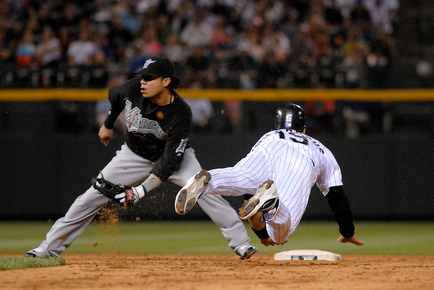 03 July 2008: Colorado Rockies outfielder Ryan Spilborghs slides into 2nd base during a successful steal against the Florida Marlins. Covering 2nd base is Marlins 2nd baseman Alfredo Amezaga. The Rockies defeated the Marlins 6-5 in 11 innings at Coors Field in Denver, Colorado. FOR EDITORIAL USE ONLY. FOR EDITORIAL USE ONLY
