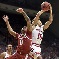 NWA Democrat-Gazette/CHARLIE KAIJO Arkansas Razorbacks guard Desi Sills (0) reaches as a Indiana Hoosiers guard Rob Phinisee (10) rebounds during the second half of the NCAA National Invitation Tournament, Saturday, March 23, 2019 at the Simon Skjodt Assembly Hall at the University of Indiana in Bloomington, Ind. The Arkansas Razorbacks fell to the Indiana Hoosiers 63-60.