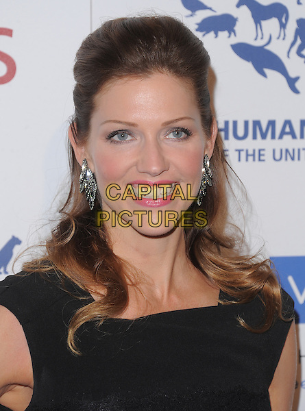 Tricia Helfer.Davey Detail. 26th Genesis Awards held at The Beverly Hilton Hotel, Beverly Hills, California, USA..March 24th, 2012.headshot portrait black pink lipstick .CAP/RKE/DVS.©DVS/RockinExposures/Capital Pictures.