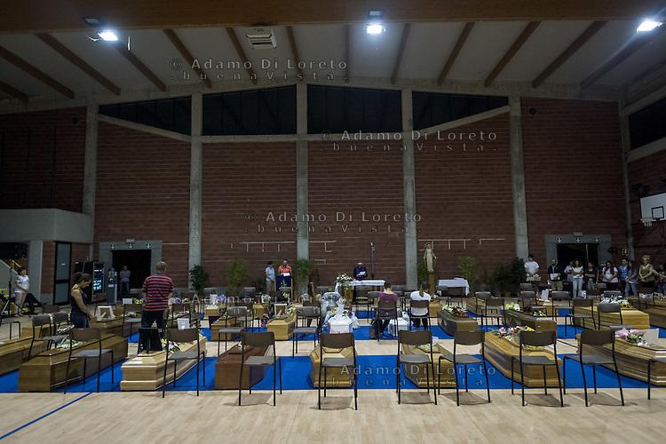 The Coffins in Ascoli Piceno during the funeral wake on August 26, 2016, in Marche, Italy. Photo by Adamo Di Loreto --- [ITA] La veglia funebre delle vittime del terremoto nelle marche, Ascoli Piceno 26 agosto 2016. Phtoto by Adamo Di Loreto