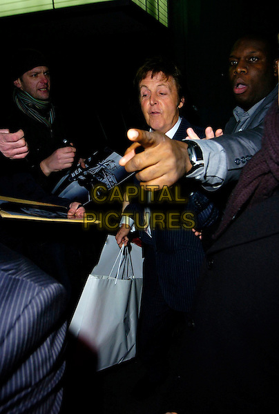 SIE PAUL McCARTNEY.The Burns Night Party, St. Martin's Lane Hotel, London, UK..January 25th, 2007.half length goody bag blue pinstripe suit hand minder bodyguard.CAP/CAN.©Can Nguyen/Capital Pictures
