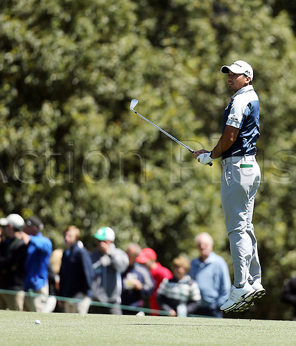 09.04.2016. Augusta, GA, USA.  Jason Day jumps up to see where the flag is on the 1st green before hitting his approach shot during the third round of the 80th Masters at the Augusta National Golf Club in Augusta, Ga., on Saturday, April 9, 2016