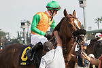 ARCADIA, CA FEBRUARY 10:  #6 Om, ridden by Flavien Prat, returns to the connections after winning the Thunder Road Stakes (Grade lll) on February 10, 2018 at Santa Anita Park in Arcadia, CA.(Photo by Casey Phillips/ Eclipse Sportswire/ Getty Images)