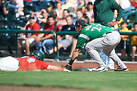 Dayton Dragons first baseman Nick O'Shea #23 tags out Austin Hedges #24 diving back to first after making too wide a turn during a Midwest League game against the Fort Wayne TinCaps at Parkview Field on August 19, 2012 in Fort Wayne, Indiana.  Dayton defeated Fort Wayne 5-1.  (Mike Janes/Four Seam Images)
