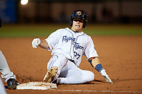 Lakeland Flying Tigers Brady Policelli (27) slides into third base during a Florida State League game against the Tampa Tarpons on April 5, 2019 at Publix Field at Joker Marchant Stadium in Lakeland, Florida.  Lakeland defeated Tampa 5-3.  (Mike Janes/Four Seam Images)