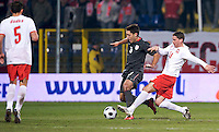 Clint Dempsey of the USA is defended by Arkadiusz Radomski of Poland. The United States defeated Poland 3-0 during an international friendly at Wisla Stadium in Krakow, Poland on March 26, 2008.