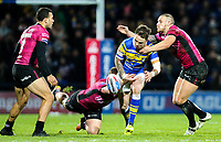 Leeds Rhinos' Richie Myler knocks on in the tackle from Hull FC 's Dean Hadley and Jordan Lane<br /> <br /> Photographer Alex Dodd/CameraSport<br /> <br /> Betfred Super League Round 5 - Leeds Rhinos v Hull FC - Thursday 8th March 2018 - Headingley Carnegie Stadium - Leeds<br /> <br /> World Copyright &copy; 2018 CameraSport. All rights reserved. 43 Linden Ave. Countesthorpe. Leicester. England. LE8 5PG - Tel: +44 (0) 116 277 4147 - admin@camerasport.com - www.camerasport.com