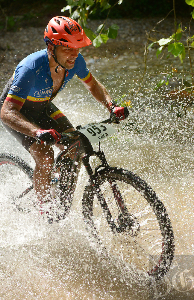 NWA Democrat-Gazette/BEN GOFF @NWABENGOFF<br /> Jeremy Black, a category 3 racer from Shawnee, Okla., fords a creek Sunday, July 16, 2017, during cross country races on the final day of the 19th annual Fat Tire Festival at Lake Leatherwood City Park in Eureka Springs.