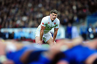 Owen Farrell of England watches a scrum. RBS Six Nations match between France and England on March 19, 2016 at the Stade de France in Paris, France. Photo by: Patrick Khachfe / Onside Images