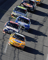 Apr 26, 2009; Talladega, AL, USA; NASCAR Sprint Cup Series driver Kyle Busch (18) leads Dale Earnhardt Jr (88) and Kurt Busch (2) during the Aarons 499 at Talladega Superspeedway. Mandatory Credit: Mark J. Rebilas-