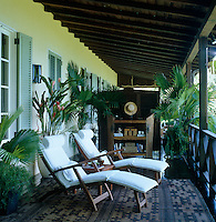 A pair of sun-loungers on one of several furnished balconies that surround the property