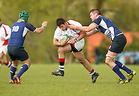 Saturday 12th May 2012  Ulster flanker Andrew Kelly is tackled by Leinster number 8 Damien Broughal and out half Paddy Behan during the Junior Inter-Provincial between Ulster and Leinster at the Glynn, Larne, County Antrim.<br /> <br /> Photo credit : John Dickson / DICKSONDIGITAL
