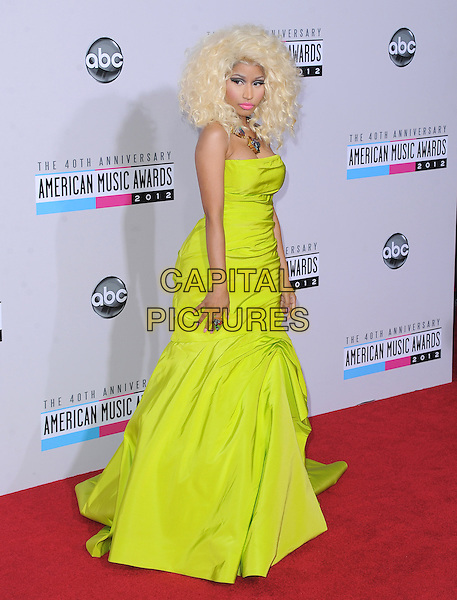 Nicki Minaj.40th Anniversary American Music Awards - Arrivals held at Nokia Theatre L.A. Live, Los Angeles, California, USA..November 18th, 2012.AMA AMAs full length yellow strapless drop waist dress side green  .CAP/DVS.©DVS/Capital Pictures.